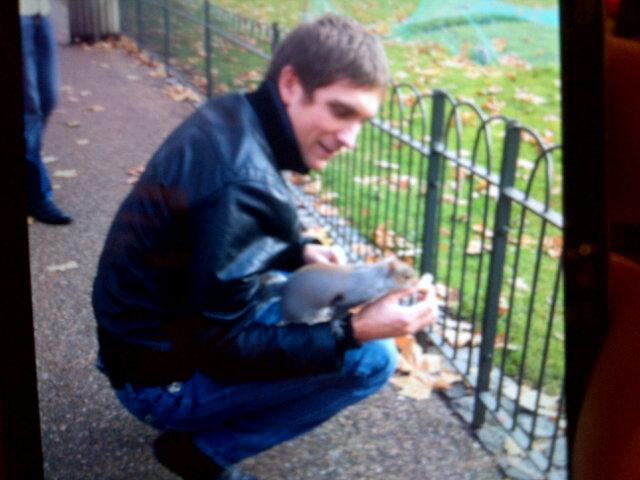 Виталий Петров с белкой на руке