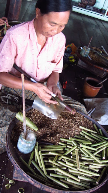 Making Burmese cigars.