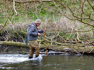Fisherman in the River Dove