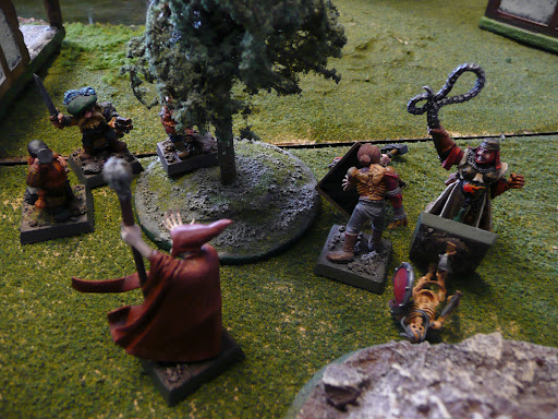 Bonecaller's forces and the dwarves clash in the eastern part of town.  Sister Hildegarde has a skeleton down, while the dwarf captain Big Boss takes aim.