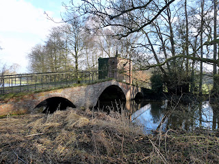 The 18th Centuary Portobello Bridge at Calwich Abbey spanning the Mill Race.