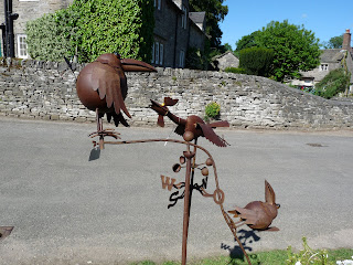 A bird weather vane.