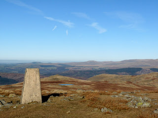 Whitfell Summit Trig Point looking towards Stainton Pike and Yoadcastle. The views were fantastic and very clear too. Holehouse Tarn can be seen underneath Stainton Pike.