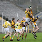 UP FOR IT: Clontibret's John Paul Mone winning a high ball despite the attention of Crossmaglen's Stephen Clarke.  Photo by Philip Fitzpatrick.