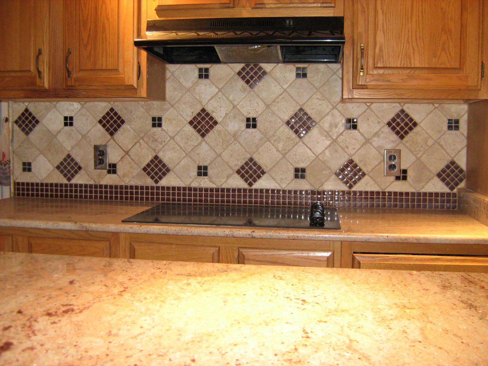 Tumbled Stone Kitchen Backsplash with Granite