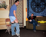 it's not what it looks like!  Troy fell off his chair while hanging up the vibe room and is showing it off to Pete