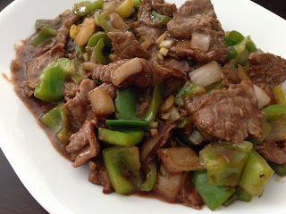 Saucy Sliced Beef with Peppers & Onions