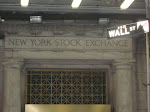 My 'clever' shot of the NYSE title and the Wall St street sign