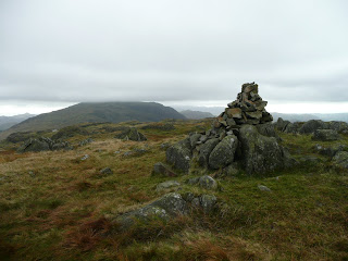Hard Knott Summit with Harter Fell in the cloud