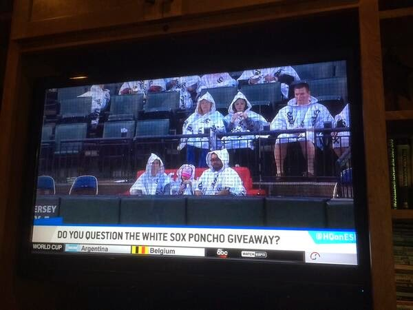 The White Sox gave out white ponchos with pointy hoods as a promotional item; it starts raining; now it looks like Klan Night at the park.