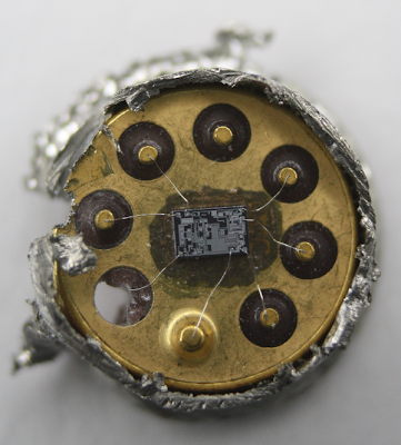 Inside a 741 op amp, showing the die. This is a TO-99 metal can package, with the top sawed off