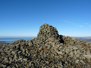 A big cairn and shelter on Whitfell