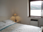 the main bedroom with view of the lake