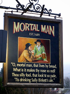 The sign hanging up at the Mortal Man