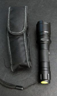P-Rocket torch and its holster. Note glow-in-the-dark switch
