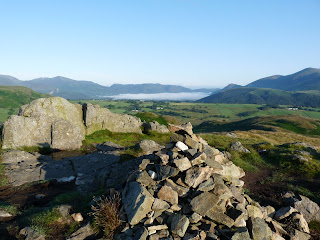 High Rigg Summit (Naddle Fell) Cairn. Bassenthwaite is covered in early morning mist.