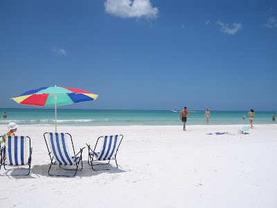 Tourist walking on the white and fine sand on the beaches of Siesta Key Clearwater picture