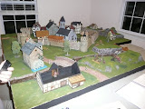 The town of Nachtdorf, only brighter.  Anti-vampire lamps deployed.