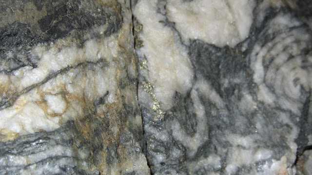 Gold-bearing veins of quartz like this are mined and processed.