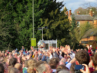 Hands reach into the air to get the Shrovetide ball