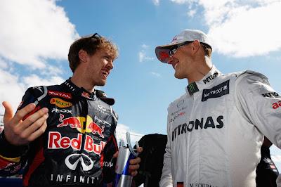 веселящиеся Себастьян Феттель и Михаэль Шумахер на Гран-при Австралии 2012