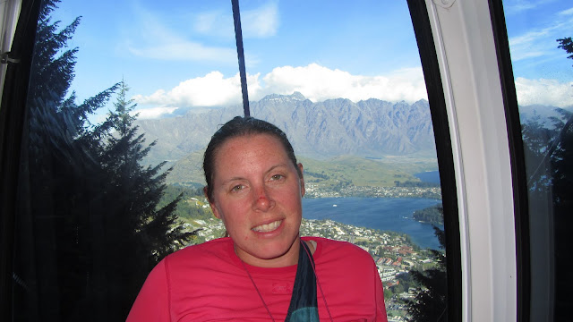 Heather forcing a smile on the gondola ride.