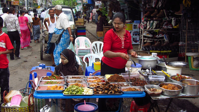 Street eats in a busy market area of Yangon.