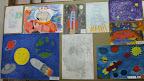 Kolāža ar skolēnu zīmējumiem par kosmosu un Gagarinu