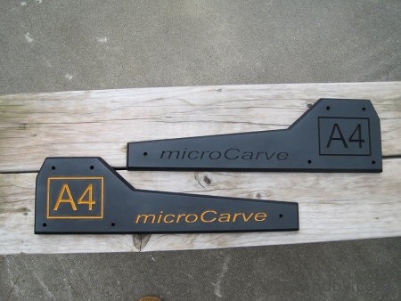 microCarve A4 CNC side panels, one is as original, one has the logo painted in with Harvest Gold paint.
