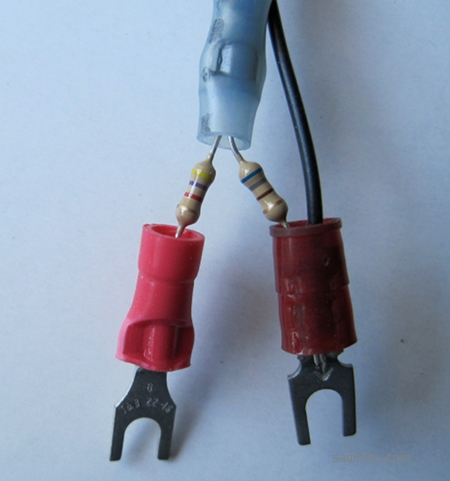 A pair of resistors on spade lugs, 4700 and 690 ohms.