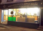 pizza takeaway lit up at night