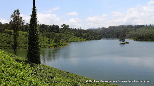 Sholayar Dam near Valparai is surrounded by tea estates making for a fantastic sight