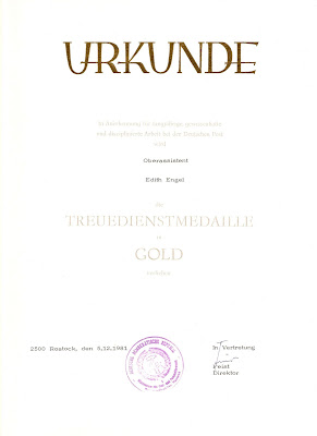 180d Treuedienstmedaille der Deutschen Post in Gold www.ddrmedailles.nl