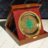 The cedar pf Lebanon impressed on a gold plated plate.
