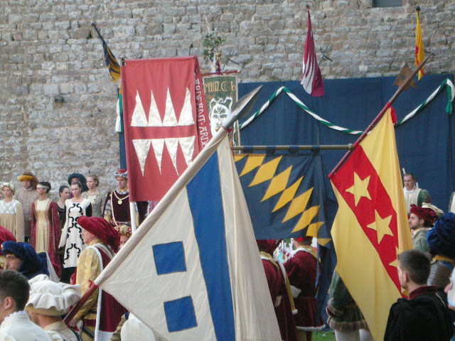 Montalcino during October's folkfest: lots of flags and medieval gear