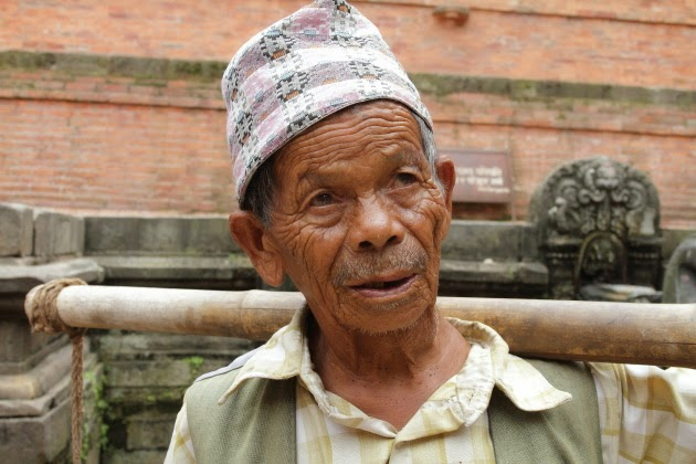 Elderly Nepali gentleman who carries water for a living at Patan, Nepal