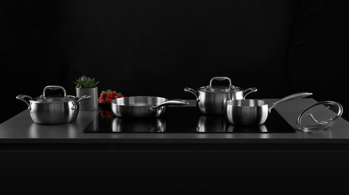 A picture containing indoor, table, kitchenware, dark  Description automatically generated