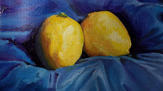 Daily Painting, oil painting of two lemons sitting on a ruffled blue silk background, the second painting