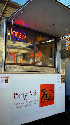 Bing Mi! Authentic Chinese Wraps from a cart in Portland. A jianbing is a savory crepe with scrambled egg, black bean paste, chili sauce, green onion, cilantro, pickled vegetables, and wonton cracker. You can get extra egg or extra cracker, or add sausage to your jian bing if you'd like.