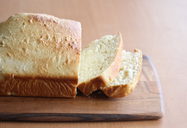 photo of the loaf of bread with two slices cut off