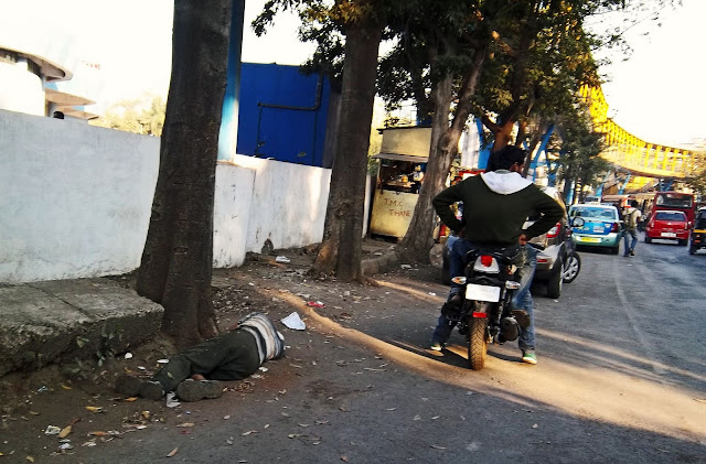 drunk man passed out on side of dusty road