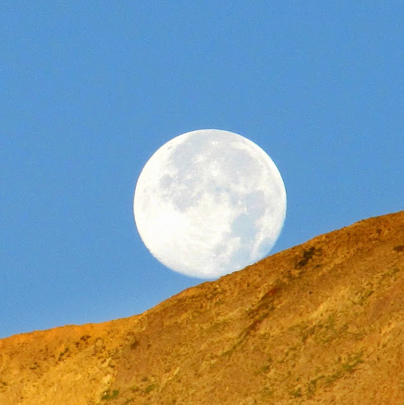 Full moon setting over Mt. Nebo