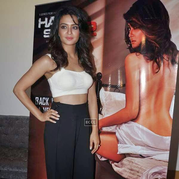 Surveen Chawla poses for the lens during the premiere of Bollywood movie Hate Story 2, held at Super Sunny Sound in Mumbai, on July 17, 2014.(Pic: Viral Bhayani)