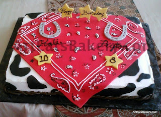 Girls cowhide red bandanna with fondant stars and horseshoes custom cowgirl birthday cake