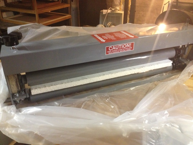 Good Fortune Press Linocut Printing On A Ceramics Slab Roller