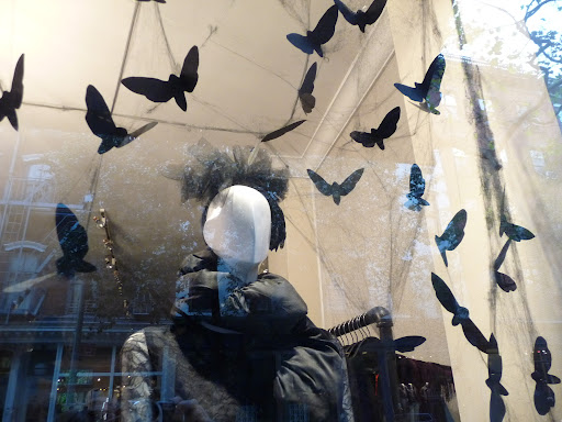 The Cynthia Rowley storefront is filled with swarms of paper moths.