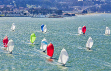 J/105s sailing under parade down San Francisco Bay