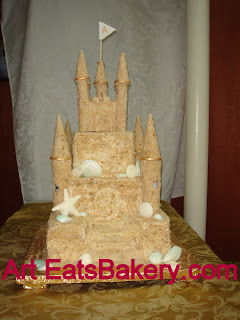 Sandcastle wedding cake with white chocolate seashells and sugar sandcastle keepsake topper