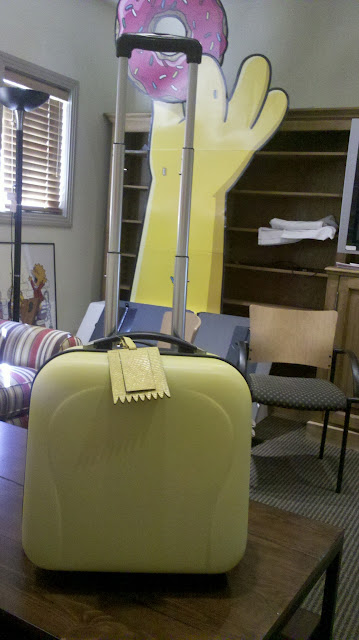 This screaming yellow case was inside complete with Bart-shaped luggage tag