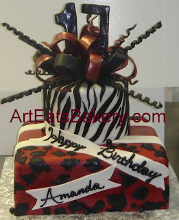 Two tier square and round garnet and black fondant zebra and leopard print custom birthday cake